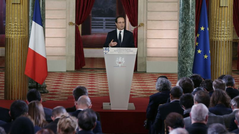French President Francois Hollande addresses a news conference at the Elysee Palace in Paris